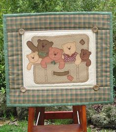 Teddlywinks has this cute traveling teddies pattern. I love the suitcase idea.