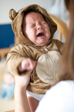 crying baby in bear costume