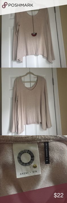 Anthropologie Akemi & Kin Cream Sweater Flowy cream sweater from Anthropologie. Has a naturally cozy look -- so soft! Wide neck and slightly scooped back. A little longer on the sides. Only worn once. Great condition. Tops Sweatshirts & Hoodies