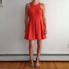 HPUO orange fit and flare dress Orange open back, fit and flare dress from urban outfitters -worn once but had very small pen mark on top, barely noticeable! Size medium (fits a size 4-6)-  brand:cooperative-  make an offer :) Urban Outfitters Dresses