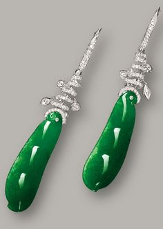 PAIR OF JADEITE 'PEAPOD' AND DIAMOND PENDENT EARRINGS Each suspending on a translucent intense emerald green jadeite, carved as a peapod, to a stylised surmount set with variously-cut diamonds, mounted in 18 karat white gold.
