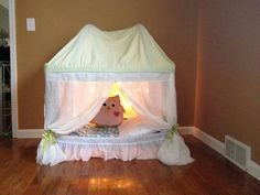 Upcycle play pen turned in a reading nook.   G;)