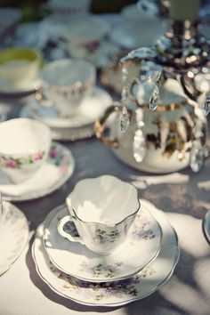 i love the contrasting focus on the tea cups and the crystals in the chandeliers.
