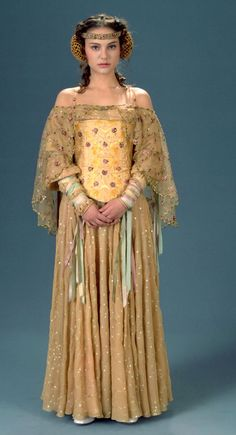 This embroidered dress and corset are worn by Padme Amidala in Star Wars Episode II. Personally my favorite of any of the costumes in the Star Wars films.