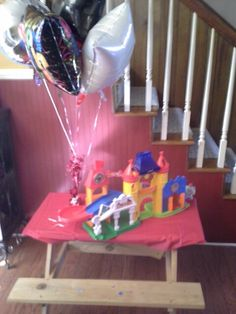Mickey mouse birthday party use toys as decorations too