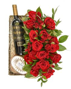 long and low red rose arrangement for the dining table Red Rose Arrangements, Red Roses, Centerpieces, Dining Table, Candles, Wine, Gifts, Dinning Table Set, Candy