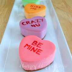 cheesecake conversation hearts recipe. She is a genius! She uses her roasting pan as a caddy and water bath for the heart shaped molds.