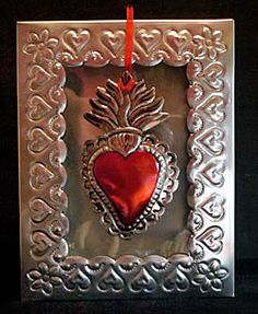 I love the colors and whimsical design in Mexican art in our friend Lisa's shop. Just in time for Valentine's Day browse these heart pendants--and don't forget the fair trade Mexican chocolate and coffee!