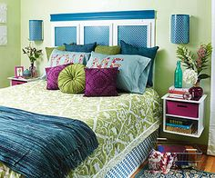 Headboard is plywood base with painted metal sheeting attached with moulding.