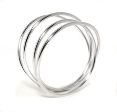 Quadruple Coil Bangle, made fro 3mm round wire  Cost approx. £120