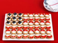 Fruit-tart Flag: If baking is not your forte, and you still want to serve up some stars and stripes then this recipe may just be for you! You can find the recipe here, but we can tell you that all you'll need to do is stir 3 simple ingredients together, use that mixture to fill premade mini-tart shells, and top with blueberries and strawberries. No one will have to know that you didn't slave for hours over them.