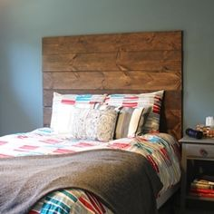 A simple way to make your own headboard out of stained wood