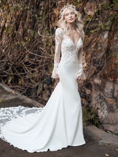 Maggie Sottero - NIKKI, You're a born romantic. It was your interest in this lace bell-sleeve mermaid wedding gown-dripping with pearls, luxuriously bohemian-that gave it away.