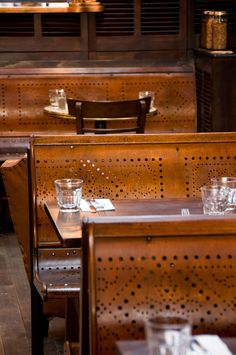100 year old tram seats become taphouse seating.The Local Taphouse Melbourne. Gardener & Marks Interior Decoration. Photography by Tim James Photography.