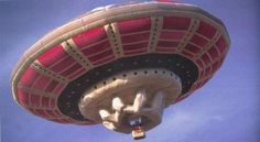 British Flying saucer shaped hot air balloon which also carried illumination, was first flown on April Fool's Day in 1989, causing a near panic among motorists in London. It was chased by police cars and identified by the Richard BRANSON, famed billionaire and president of the Virgin Group.