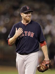 Boston Red Sox's Aaron Cook smiles as he is taken out of the baseball game against the Oakland Athletics in the third inning Friday, Aug. 31, 2012, in Oakland, Calif. (AP Photo/Ben Margot)