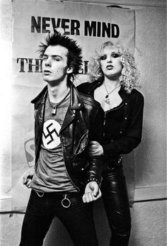 """[Sid Vicious, bassist for the Sex Pistols, and girlfriend Nancy Spungen] The swastika is a clear example of #appropriation within the punk subculture. According to Hebdige, punks were typically unsympathetic to parties of the extreme right (116). In fact, punk subculture grew out of an """"antithetical response to the reemergence of racism in the mid-70's,"""""""