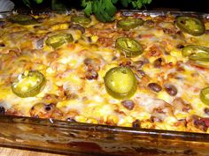 MEXICAN BEEF CASSEROLE: Brown 1 lb ground beef, 1 med onion, drain. Add 1 can corn,1 can black beans (rinsed/drained), tomatoes, 1 pkg taco seasoning. Mix well, simmer 5 min.  Spray 8x12 baking dish. Place 6 tortillas in bottom.Spoon 1/2 beef mixture on top, place 3/4 c. nonfat sour cream over beef. Layer 6 more tortillas and beef mixture. Bake 25 min at 350 degrees. Remove from oven.  Sprinkle w/ shredded taco cheese & sliced jalapenos peppers. Cook 5 min so cheese melts. Let stand 5 min.