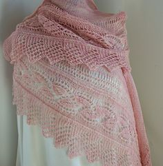 Linnéa Shawl.This is a crescent shape shawl, worked flat in a wool fingering yarn. Free on ravelry