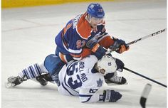 Toronto Maple Leafs' Dave Bolland collides with Edmonton Oilers forward Ryan Nugent-Hopkins during a game at Rexall Place in Edmonton on Oct...