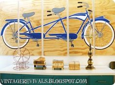 DIY Tandem Bicycle Wall Art - project an image on to some wood, hang, done!  Maybe I'd do something other than a bike, but this is a cheap wall art idea.
