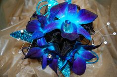 Blue dendrobium orchids and black ribbon accented with gems. Very cool.