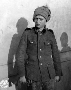 Portrait of a teenage German soldier of the 4th SS Panzergrenadier Regiment Der Führer after being taken as a POW by the U.S. 3rd Armored Division during the Battle of the Bulge. Near St. Vith, Liège,...