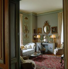"House of Windsor, Paris - In the Duchess of Windsor's bedroom the red tones of an elaborate Persian rug create a pleasing contrast to pale blue upholstery and walls painted a subtle turquoise, her favourite colour and known as ""Wallis Blue"" Wallis Simpson, Red Persian Rug, Fritz, House Of Windsor, Interior Decorating, Interior Design, Paris Apartments, Blue Bedroom, Duke And Duchess"