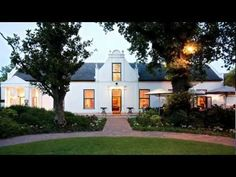 Erinvale Estate Hotel & Spa Somerset West Steeped in history, surrounded by the majestic Hottentots Holland Mountains and neighbouring the magnificent Erinvale Golf Course, the Erinvale Estate Hotel & Spa promises a peaceful and memorable stay. Cape Town Hotels, Cape Dutch, Somerset West, Public Golf Courses, Facade House, House Facades, Spa Offers, Hotel Spa, Adventure Is Out There