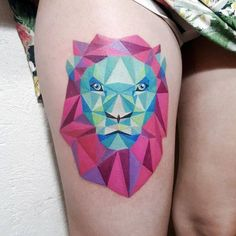 Cubist lion tattoo on the right thigh.