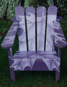 Painted Adirondack chair. Chanticleer Garden, an estate & garden in Wayne, Pennsylvania.