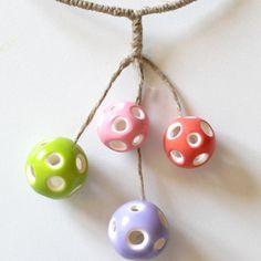collier perles creuses en pte polymre cernit