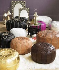a gold or white pouf would be great in a nursery