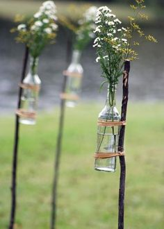twig yard stake with bottle vase: would be fun to use for an outdoor event