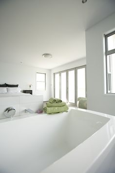 Looking back to the bed and the view in this open plan bedroom bathroom