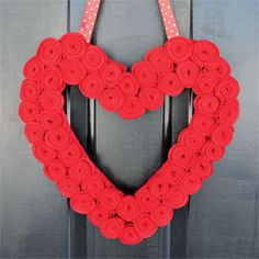 Valentine's Day is on its way! Celebrate with this heart-shaped wreath and give your front door some love. We show you how! Photo by Gina Bell.