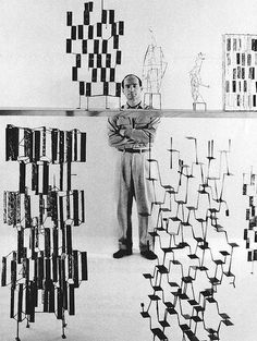 sculptor Harry Bertoia with some of his work.