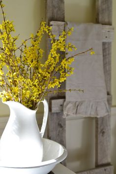 Forsythia, a great flower for a yellow themed early springtime wedding! It means good nature, innocence, and anticipation! I am loving these pops of yellow! Farmhouse Decor, Farmhouse Style, Driven By Decor, Upstairs Bathrooms, Small Bathroom, White Vases, White Pitchers, Yellow Bathrooms, Mellow Yellow