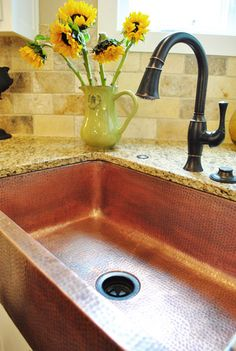 Not at all a rustic country girl, but I LOVE the color of this sink against that granite counter and dark fixtures!