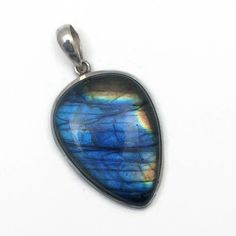 Labradorite is a stone of transformation of intuition into intellectual thought. It assists with implementing inner messages and gives clarity to the issues at hand.  Labradorite pendent in sterling silver.