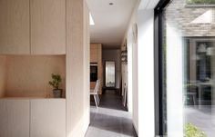 31/44 Architects builds grey-brick house around three small courtyards