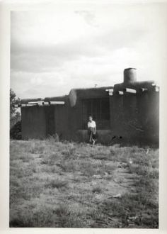 """Maria Chabot, """"Georgia O'Keeffe, Ghost Ranch House Exterior,"""" 1944. Photographic print, 5 x 3 1/2 in. Georgia O'Keeffe Museum. Gift of Maria Chabot. RC-2001-002-127a. Copyright Georgia O'Keeffe Museum."""