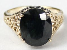 R057, Midnight Blue Natural Sapphire, 10KY Gold Ring * Stone Type - Midnight Blue Natural Sapphire * Approximate Stone Size - 12x10mm  * Approximate Stone Weight - 6 cts  * Jewelry Metal - Solid 10k Yellow Gold * Approximate Metal Weight - 3.8 grams  * Ring Size - Size selectable during checkout * Our Warranty - A full year on workmanship  * Our Guarantee - Totally unconditional 30 day guarantee