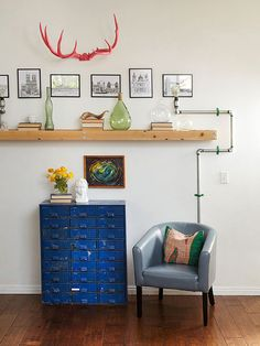The perfect mix of retro and industrial elements yields a DIY pipe sconce and floating shelf: http://www.bhg.com/decorating/decorating-style/flea-market/house-tour--fresh-retro-style/?socsrc=bhgpin110614decoratingingenuity&page=5