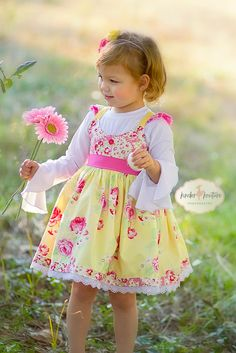 Girls handmade boutique dress in a gorgeous yellow floral fabric from Designer Tanya Whelan. Lovely details include flutter sleeves, elasticized back, eyelet lace along the hem. All items are made wit