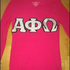 Only worn twice. Stitched long sleeve shirt with the Greek letters Alpha Phi Omega. Black background letters with glittery silver letters on top. Perfect condition!
