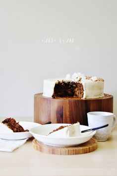 Finally! The moistest Carrot Cake ever with a Coconut Vanilla Bean Mousse frosting that's all natural, vegan, and gluten free!