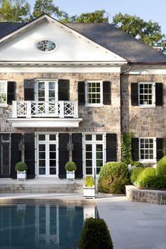Limestone pool terrace and garden by Howard Design Studio.
