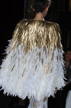 Advanced accessorizing: a cape of feathers in white and metallic gold. By Zuhair Murad, Haute Couture Spring 2013
