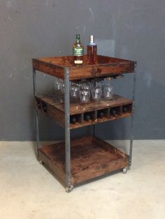 @ #bareknuckleworkshop in Chicago-Custom Industrial Bar Cart made of pine, steel and black pipe with casters in Red Oak Stain